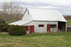 Old wood  barn with red door Royalty Free Stock Photography