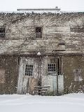 Old Barn in Snow Storm, Doorway Centered in Frame Royalty Free Stock Photo