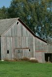 Old wood barns in the Midwest. These old wood barns are becoming a thing of the past as they no longer service a purpose on large farms stock photography