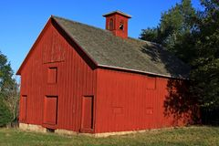Midwest Barns. Old wood barns dot the landscape, most unused due to farming & ranch practices with larger equipment royalty free stock photo