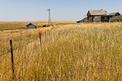 Old wood barns and stables in North dakota countryside. Old wood barns and stables in North dakota great plains countryside royalty free stock image