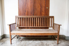 Old wood bench. Front view of old wood bench in front of door Royalty Free Stock Image