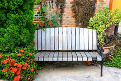 Old wood bench in garden Stock Images