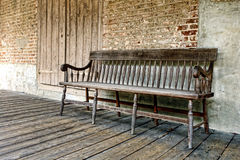 Old Wood Bench on a Historic House Porch Stock Photos