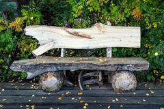 Old wood bench. Wood bench made of old tree trunks royalty free stock photos
