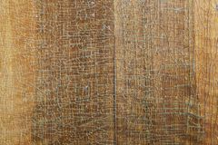 Old wood board with cracked lacquer. Old wood board closer texture background with cracked lacquer Royalty Free Stock Image