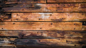 Old wood boards on the deck. And the hull of the ship stock images