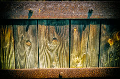 Old wood boards texture with rusty metal panel Stock Images