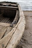 Old wood boat on the sea cost stock photos