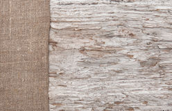 Old wood bordered by burlap Royalty Free Stock Photos