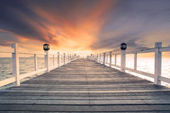 Old wood bridg pier with nobody against beautiful dusky sky use Royalty Free Stock Photos