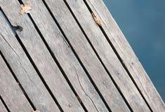 Old wood bridge floor with autumn leaf Stock Images