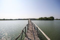 The old wood bridge in lake of Chumphon Thailand. Beautiful place royalty free stock image