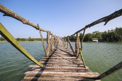 The old wood bridge in lake of Chumphon Thailand. Beautiful place Stock Photo