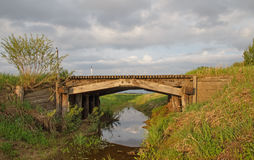 Old wood bridge over ditch Royalty Free Stock Images