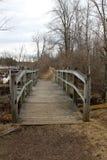 Old wood bridge over marsh water Stock Photography