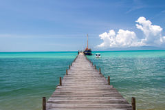 Old wood bridge pier and blue sky, Andaman Sea,  thailand Stock Photography