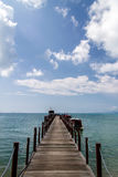 Old wood bridge pier and blue sky, Andaman Sea,  thailand Royalty Free Stock Images