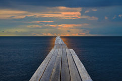 Old wood bridge into the sea. Seem like journey to the target Royalty Free Stock Photo