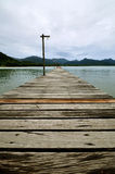 Old wood bridge to the sea Royalty Free Stock Photography