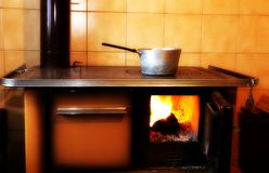 Old wood-burning stove in the kitchen of ancient home Stock Image
