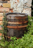 Old wood cask. In front of a brick wall Royalty Free Stock Images