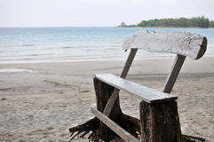 Old wood chair at the beach Stock Image