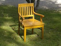 Old wood chair on the grass Stock Image