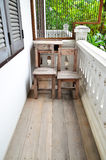 Old wood chair on terrace. Old wood chair on wood terrace Royalty Free Stock Photography