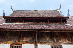 Old wood chapel lanna style in thai temple Royalty Free Stock Images