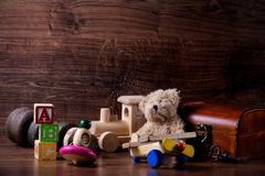 Old wood children toys with teddy bear stock photo
