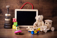 Old wood children toys with teddy bear. Collection of old wood children toys with teddy bear Stock Image