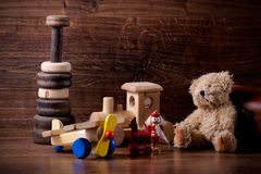 Old wood children toys with teddy bear Stock Photos