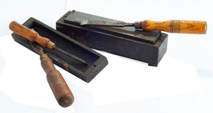 Old wood chisels and oilstone Stock Photos