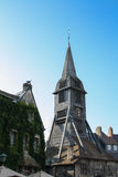 Old Wood Church. View of an old wood church with a clock in France Royalty Free Stock Images