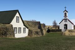 This is an old wood church in South Iceland and a farm turf house very traditional.