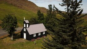 This is an old wood church in South Iceland and is very traditional.