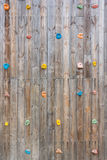Old wood climbing wall with toe and hand hold studs. Grunge surface of old wood climbing wall with toe and hand hold studs royalty free stock photo