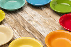 Old wood and color bowls Stock Photo