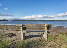 Old wood and concrete bench facing Penobscot River, Maine. An old wood and concrete bench facing the Penobscot River at Sandy Point Beach in Stockton Springs Stock Images