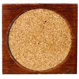 Old wood and cork table coaster Royalty Free Stock Photo