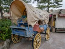 An old Covered wagon and instrument, tool, device, gadget, machine, appliance royalty free stock photos