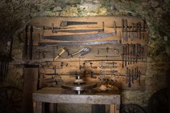Old wood craft tools. Hanging on a wall stock photography