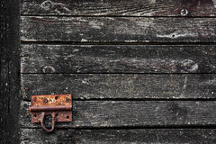 Old wood dark grunge texture for background with rusty door latch Stock Image