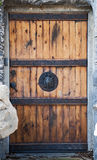 Old Wood Door. Old reinforced wood door with a turtle door knob and metal braces Royalty Free Stock Photos