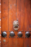 Old Wood Door. An old reddish-brown wood door with a lion knocker in the old city of Jerusalem Stock Photos