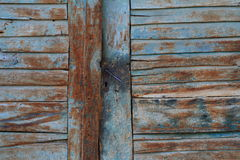 Old wood door. Old blue door in an alley Stock Image
