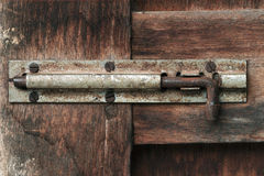 Old wood door bolt Stock Image