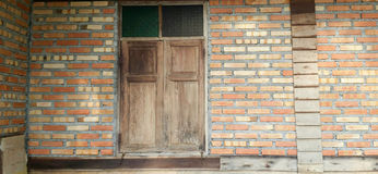 Old wood door and brick wall Royalty Free Stock Images