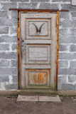 Old wood door in bricks wall Stock Photo
